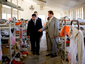 California Gov. Arnold Schwarzenegger, right, and officials tour a prison last week in Chino after a riot there.