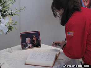 Mourners sign condolence books at the John F. Kennedy Presidential Library in Massachusetts.