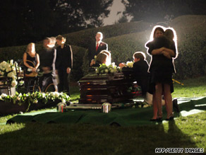 Sen Edward M. Kennedy's widow, Vicki, second from left, touches her husband's casket.