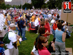 Thousands gather on the National Mall west of the Capitol for Saturday's tea party rally.