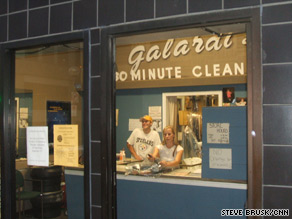 """Another business in Pittsburgh sports """"Welcome"""" banners on plywood covering the windows."""