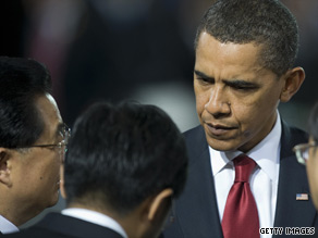 President Obama speaks with Chinese President Hu Jintao, left, at the Group of 20 plenary session Friday.