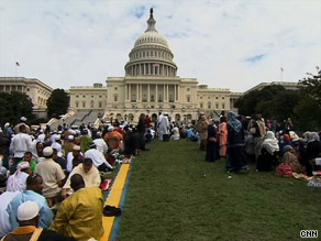 Muslims bow in prayer Friday at the event, which was meant to inspire American Muslims and non-Muslims.