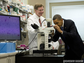 President Obama looks at a microscope with Dr. Marston Linehan at the National Institutes of Health on Wednesday.