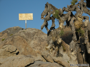 A judge ruled the Mojave Cross must be covered until a First Amendment issue can be resolved.