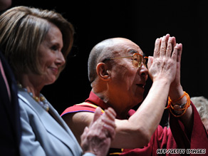 The Dalai Lama sits with House Speaker Nancy Pelosi at the awards ceremony on Tuesday.