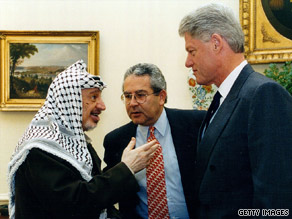 Gamal Helal (middle) assists during a meeting between Yassar Arafat and then-president Bill Clinton.
