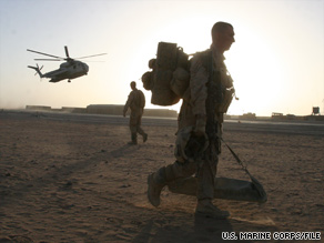 Troops prepare to board helicopters at Forward Operating Base Dwyer, Afghanistan.
