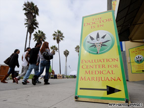 Signs beckon patients into a medical marijuana clinic in Los Angeles, California.