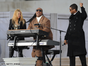 Stevie Wonder, center, performs with Shakira and Usher at a concert Sunday at the Lincoln Memorial in Washington.