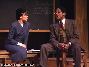 "Jasmine Guy and co-star TC Carson in a scene from the play ""Miss Evers' Boys."""