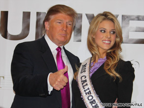 Donald Trump poses with Carrie Prejean in May. Prejean was removed as Miss California USA on Wednesday.