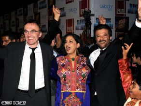 "Danny Boyle, left, celebrates with actor Anil Kapoor, right, at the Mumbai premiere of ""Slumdog Millionaire."""