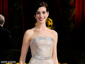 Anne Hathaway accessorized her Armani Prive gown with more than $1 million worth of Cartier jewelry.