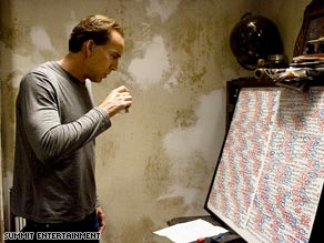 "In ""Knowing,"" a physics professor (Nicolas Cage) ponders patterns in a list of numbers."