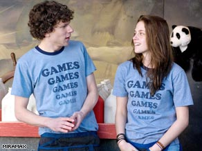 "Jesse Eisenberg tries to strike up a relationship with Kristen Stewart in ""Adventureland."""
