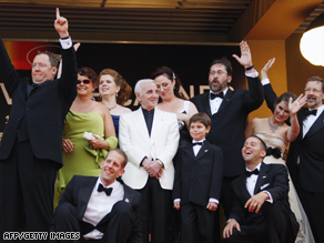 "The crew of ""Up"" pose for photographers ahead of the animated movie's premiere at Cannes."