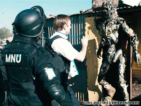 "A company operative (Sharlto Copley) gets an alien's attention in ""District 9."""