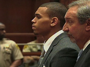 The argument between Rihanna and Brown, shown here last year, began with a text message, said police.