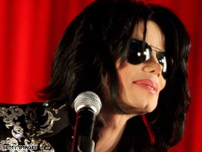 A Michael Jackson impersonator is interviewed outside the London hotel where the singer is staying.