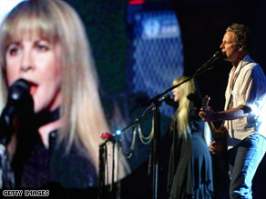 Fleetwood Mac is back on the road with Stevie Nicks and Lindsey Buckingham, shown performing in 2004.