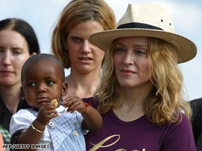 Madonna holds her adopted Malawian son, David Banda, in 2007.