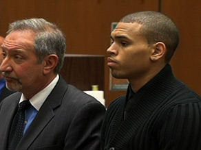 Singer Chris Brown, right, appeared in court Monday on charges of assaulting singer Rihanna.