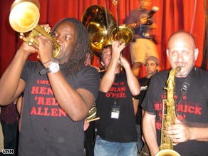 Shamarr Allen, Mark Mullins and Ben Ellman sport the Midnite Disturbers T-shirts as they perform.