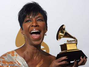 "Natalie Cole holds one of the Grammys she received in February for ""Still Unforgettable."""
