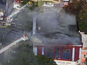 The Georgia Theatre in Athens, Georgia, smolders after firefighters put out a morning blaze.