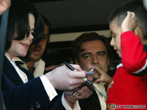 Prices are expected to grow for Michael Jackson autographs like the one he gave this young fan in 2002.