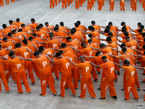 The prisoners performed in searing heat Saturday.