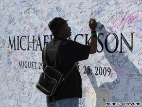 A fan leaves a note on a Michael Jackson memorial outside the Staples Center in Los Angeles.