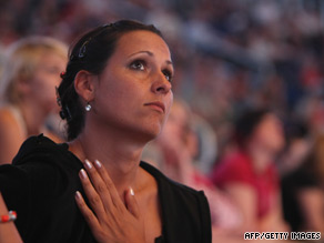 A Michael Jackson fan in Berlin watches footage of the memorial concert.