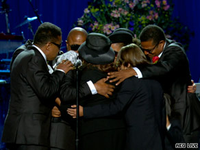 Jackson's family embrace each other on stage during the close of the emotional service.