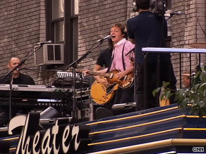 Paul McCartney performs Wednesday on the roof above the marquee of New York's Ed Sullivan Theater.