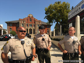 Police stand outside the Los Angeles County Coroner's Office when Michael Jackson's body was there in June.