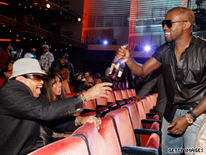 Joe Jackson, left, talks with Kanye West at the 2009 MTV Video Music Awards on Sunday.
