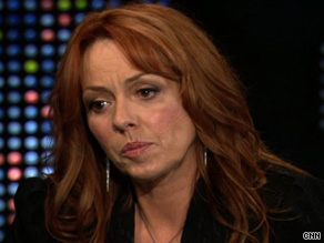 "Mackenzie Phillips tells CNN's ""Larry King Live"" that her father raped her in 1979."