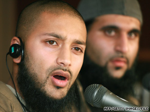 Ruhal Ahmed, left, shown at a 2007 news conference, says he had to listen to hours of music at Guantanamo.