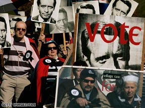Fans holding placards of Patrick McGoohan recreate a scene from 'The Prisoner' to celebrate the 40th anniversary of the show in 2007.