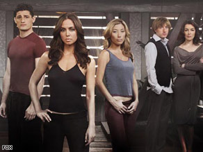 "Eliza Dushku (second from left) stars as a kind of programmed actor on ""Dollhouse."""