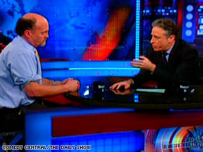 Jim Cramer, left, appears on &quot;The Daily Show&quot; Thursday with host Jon Stewart.