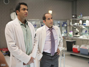 "Kal Penn, left, with Peter Jacobson on ""House,"" is joining the Obama White House."