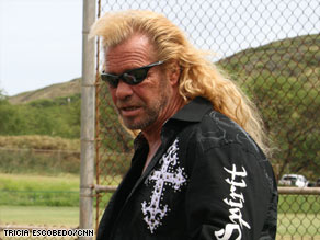 "Duane ""Dog the Bounty Hunter"" Chapman watches his son's baseball game this month in Honolulu, Hawaii."