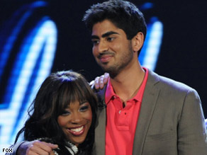 "Lil Rounds hugs fellow ""American Idol"" contestant Anoop Desai on Wednesday's show."