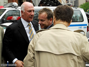 Kiefer Sutherland, center, turns himself in to police in New York on Thursday.