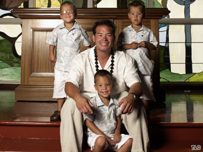 Jon Gosselin, here with his sons, was photographed on vacation with another woman.