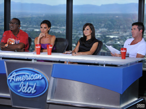 "Simon Cowell, right, says season nine of ""American Idol"" is different without Paula Abdul."