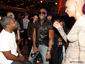 Kanye West, center,  with girlfriend Amber Rose and actor Tracy Morgan at the 2009 MTV VMAs.
